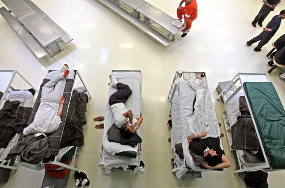 Detainees pass the time in one of the pods of the Northwest Detention Center's 1575-bed facility as they wait for a decision on their cases. Dean J. Koepfler/The News Tribune