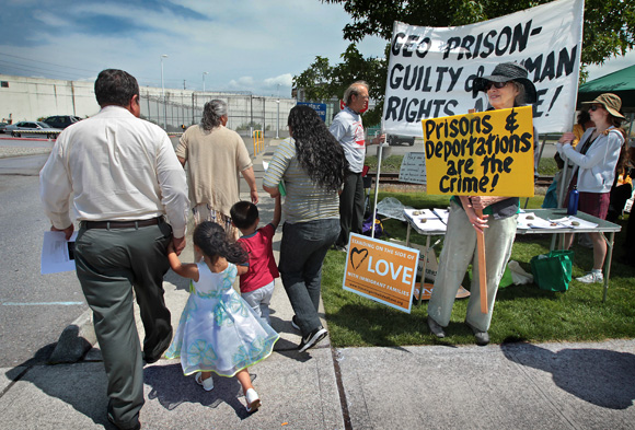 Children dressed up for a visit with family members detained in the Northwest Detention Center pass by immigration activists at a recent protest in front of the facility. Dean J. Koepfler/The News Tribune