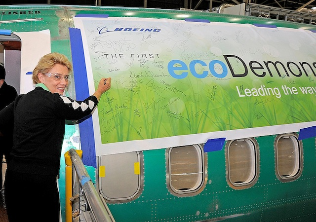 Gov. Chris Gregoire signs a 737 used to test new technologies at Boeing's Renton, Wash., facility during