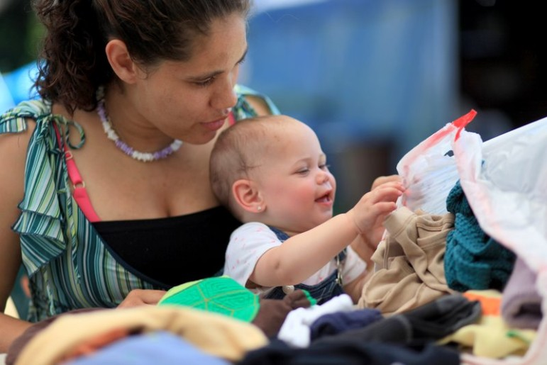 Casi Jackson and daughter look through second-hand clothes at Tent City in Kirkland, where Jackson volunteers