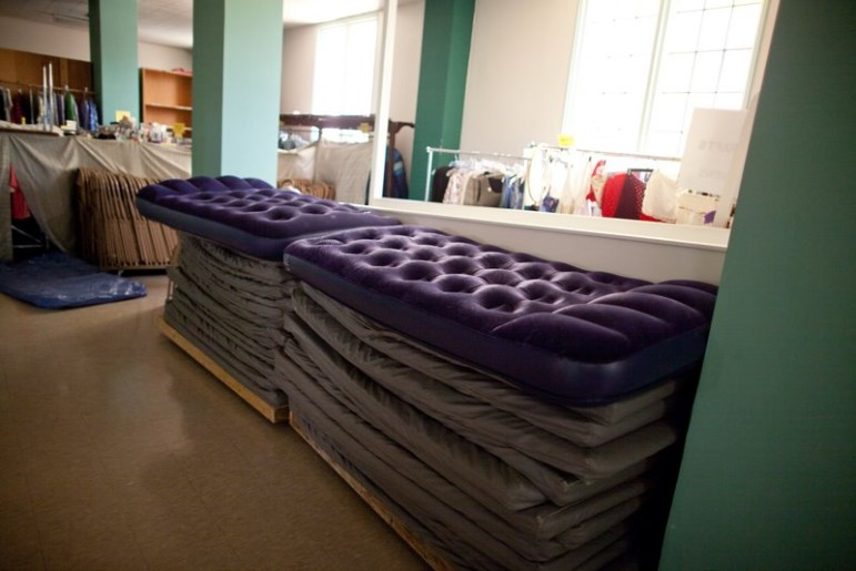 Cots are stacked in a homeless youth shelter in Seattle.