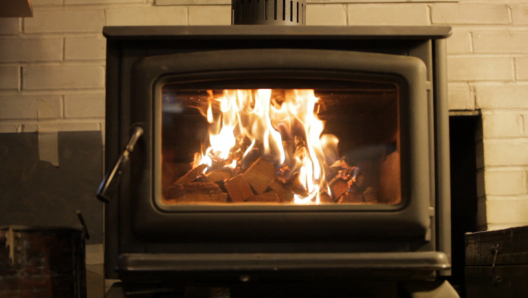 Newer EPA-certified stoves cut emissions signficantly. They typically cost $2,500 or more.