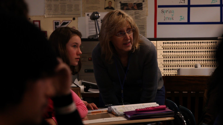 Billie Lane helps a student during class.