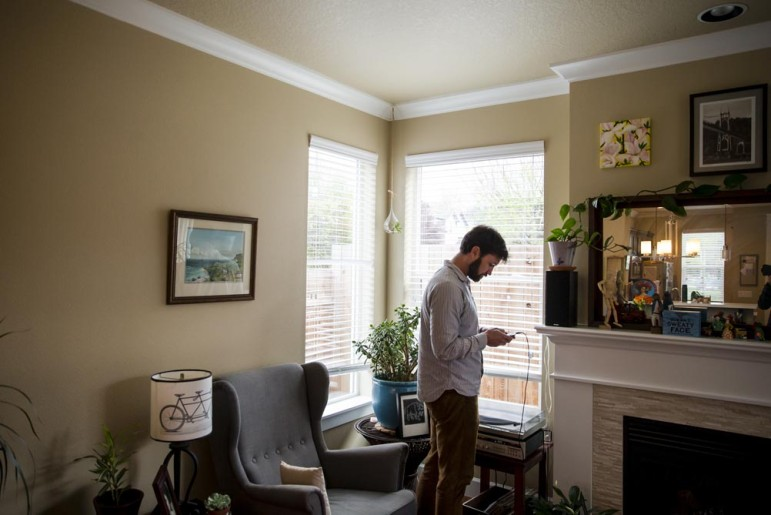 Justin Buri at his home in the St. Johns neighborhood on a recent April evening. Buri has seen firsthand the pressures of a changing housing market at his job with the Community Alliance of Tenants.