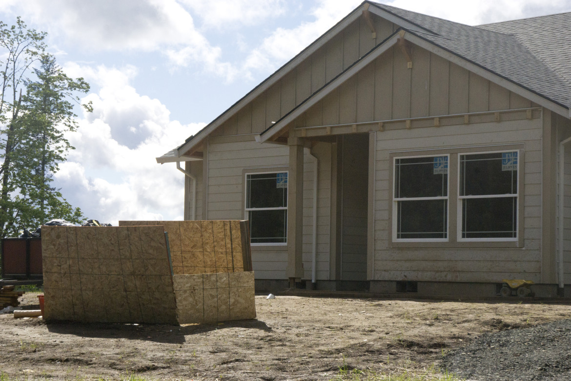 A newly built house stands where a family-owned forest used to. The land was sold when the former owners died.