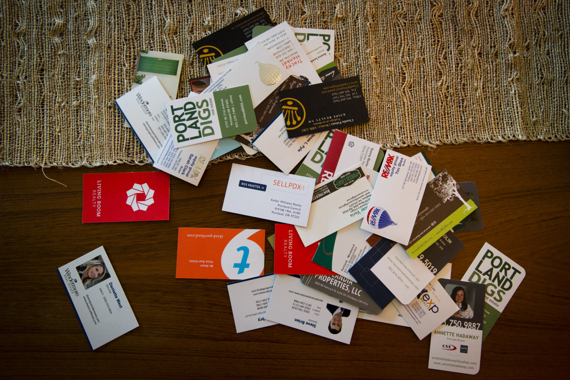 A home in the Woodstock area of Portland that was just put on the market is inundated with real estate agents' cards.