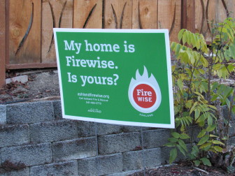 Many homes in the Mountain Ranch subdivision in Ashland, OR display these signs to show their participation in the Firewise program to reduce wildfire vulnerability.