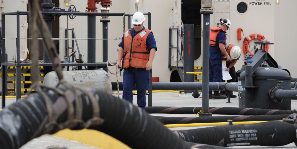 Coast Guard officers inspect an oil barge in Tacoma, Wash.