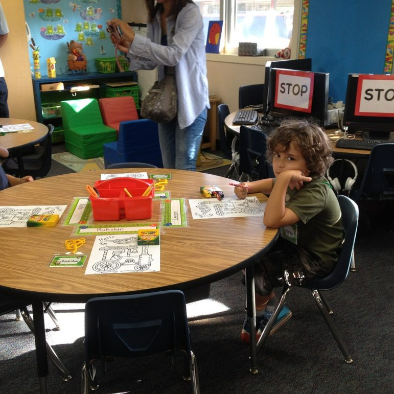 A child sits in a classroom. Studies show that frequent moves many foster kids endure set them up for failure in school.