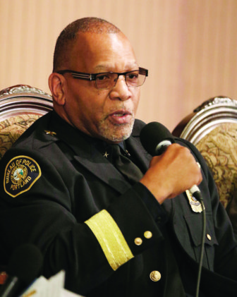 Assistant Portland Police Chief Kevin Modica talks during a panel discussion on race and police policy at the City Club.