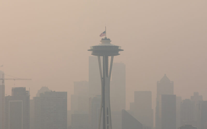 Wildfire smoke obscures the view of the Space Needle and the skyline in a view from Seattle's Kerry Park.