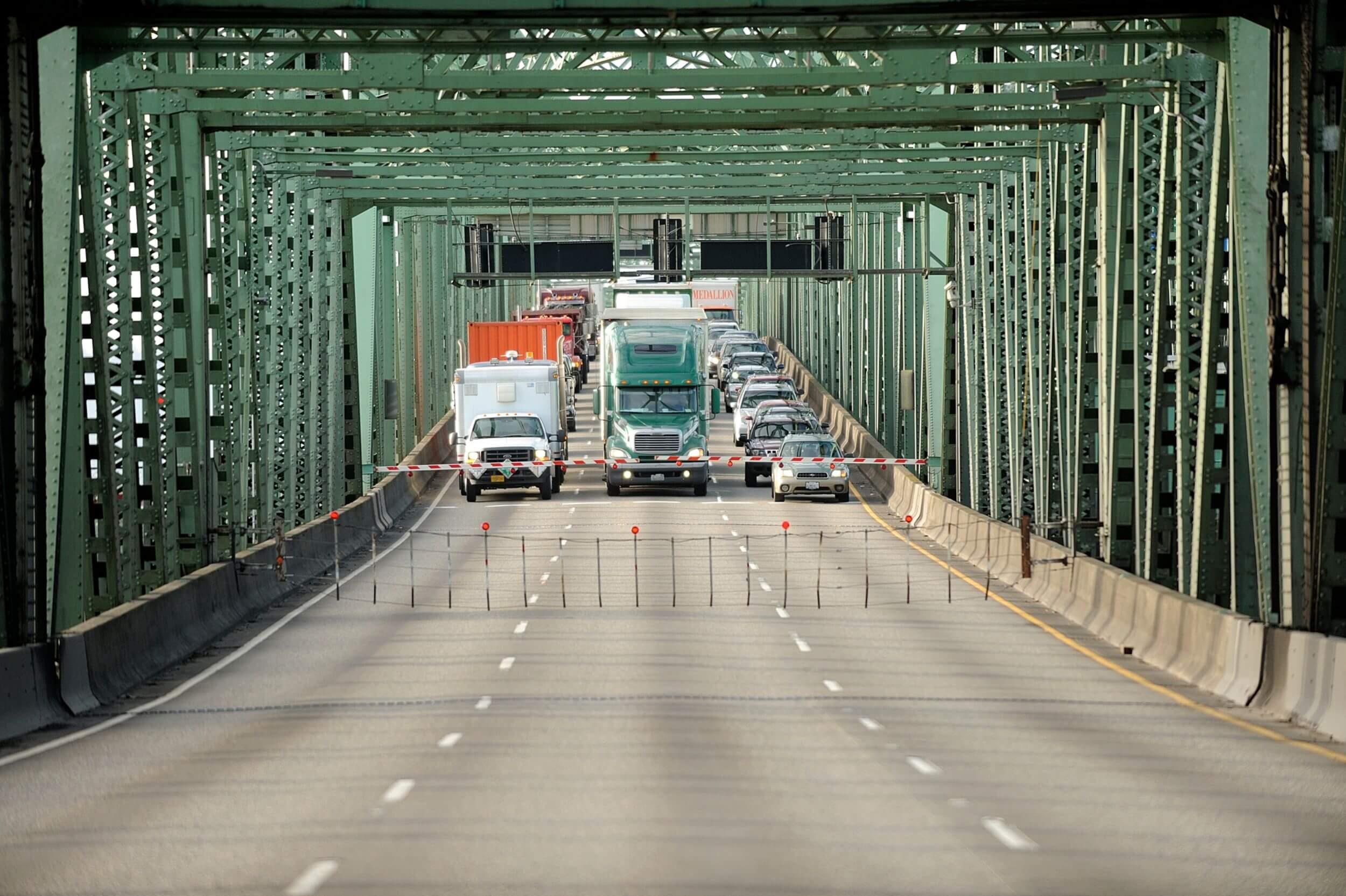 A shot of a car bridge made of green metal.