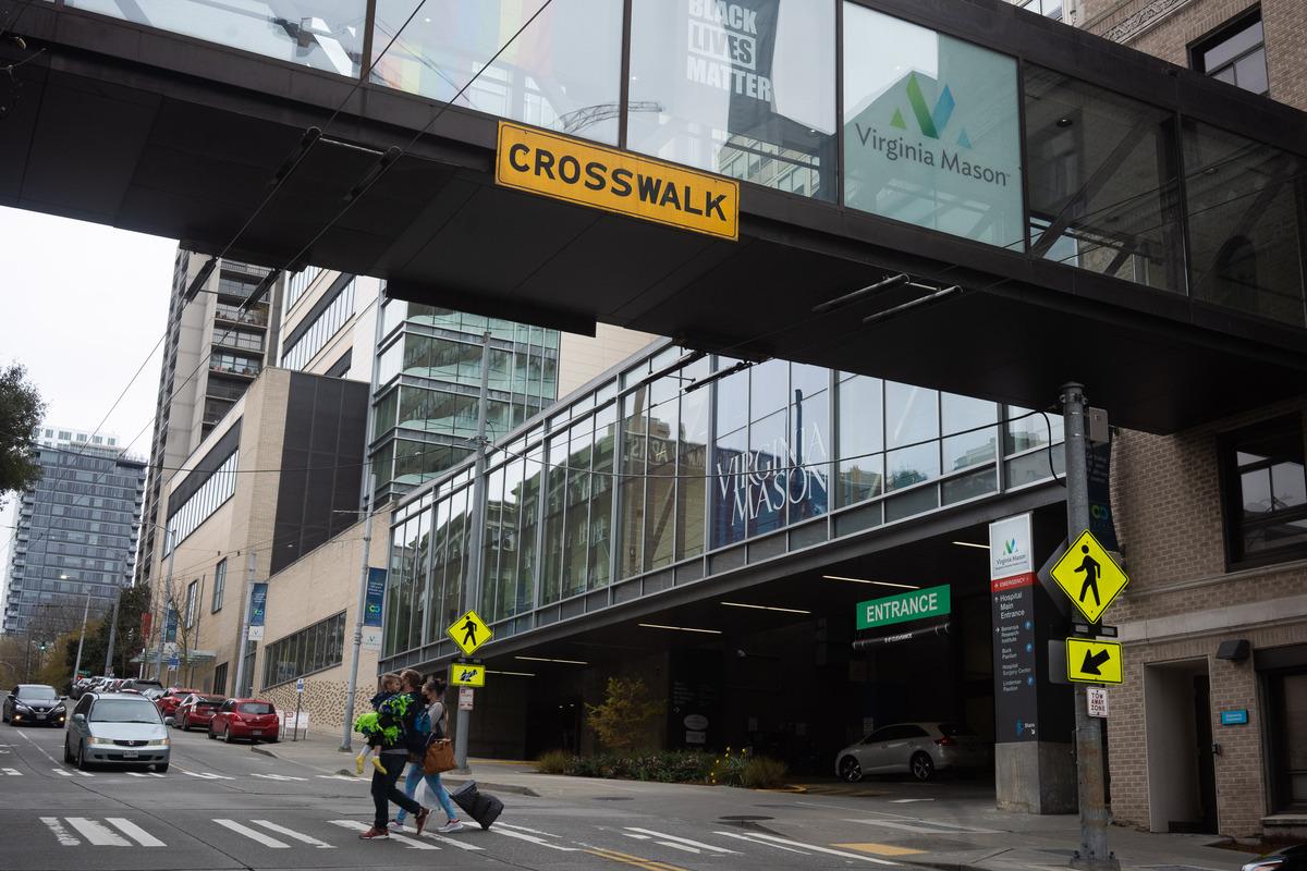 A crosswalk outside a hospital building.