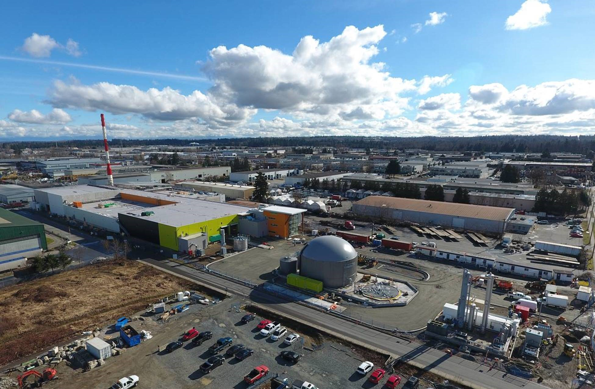 An aerial shot of a biofuel facility during the daytime.